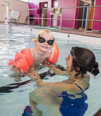 Adult & Child Swimming Image